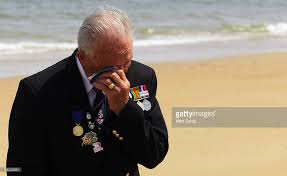 vet crying on Normandy beach
